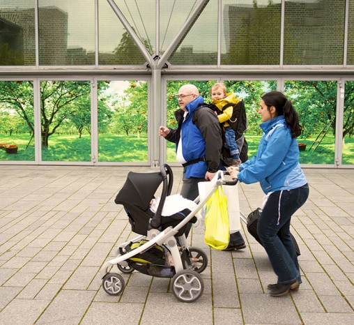 Family walking with a baby buggy