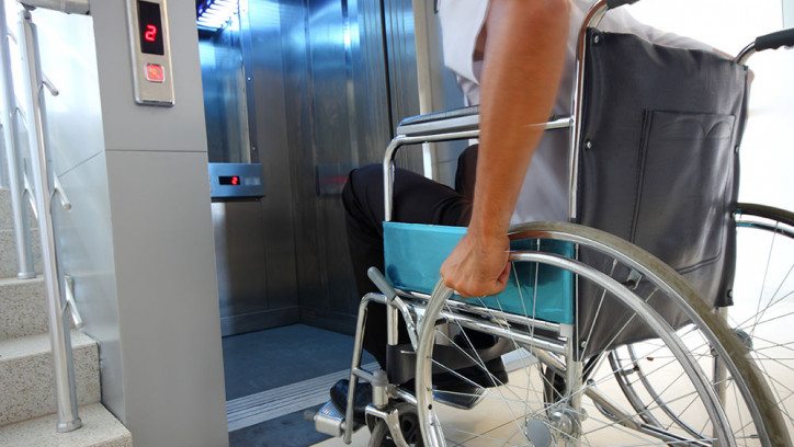 Man in a wheelchair entering a lift
