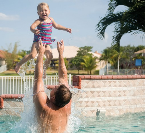 Father and daughter in a swimming pool