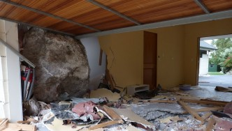 Large rock crashed through garage wall