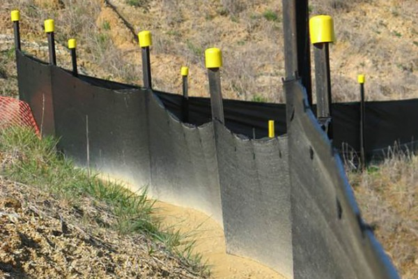 Example of a silt fence on the downhill side