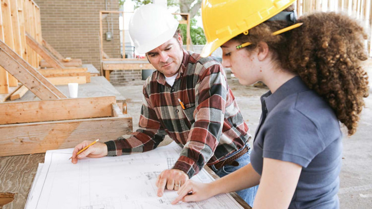 Building professionals discussing design plans