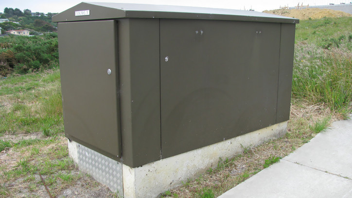 Concrete plinth supporting a utility cabinet