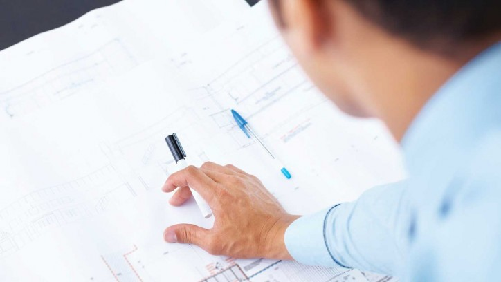 Building professional with design plans